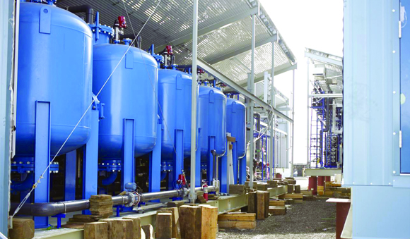 Industries - Workers camp blue tanks water treatment system